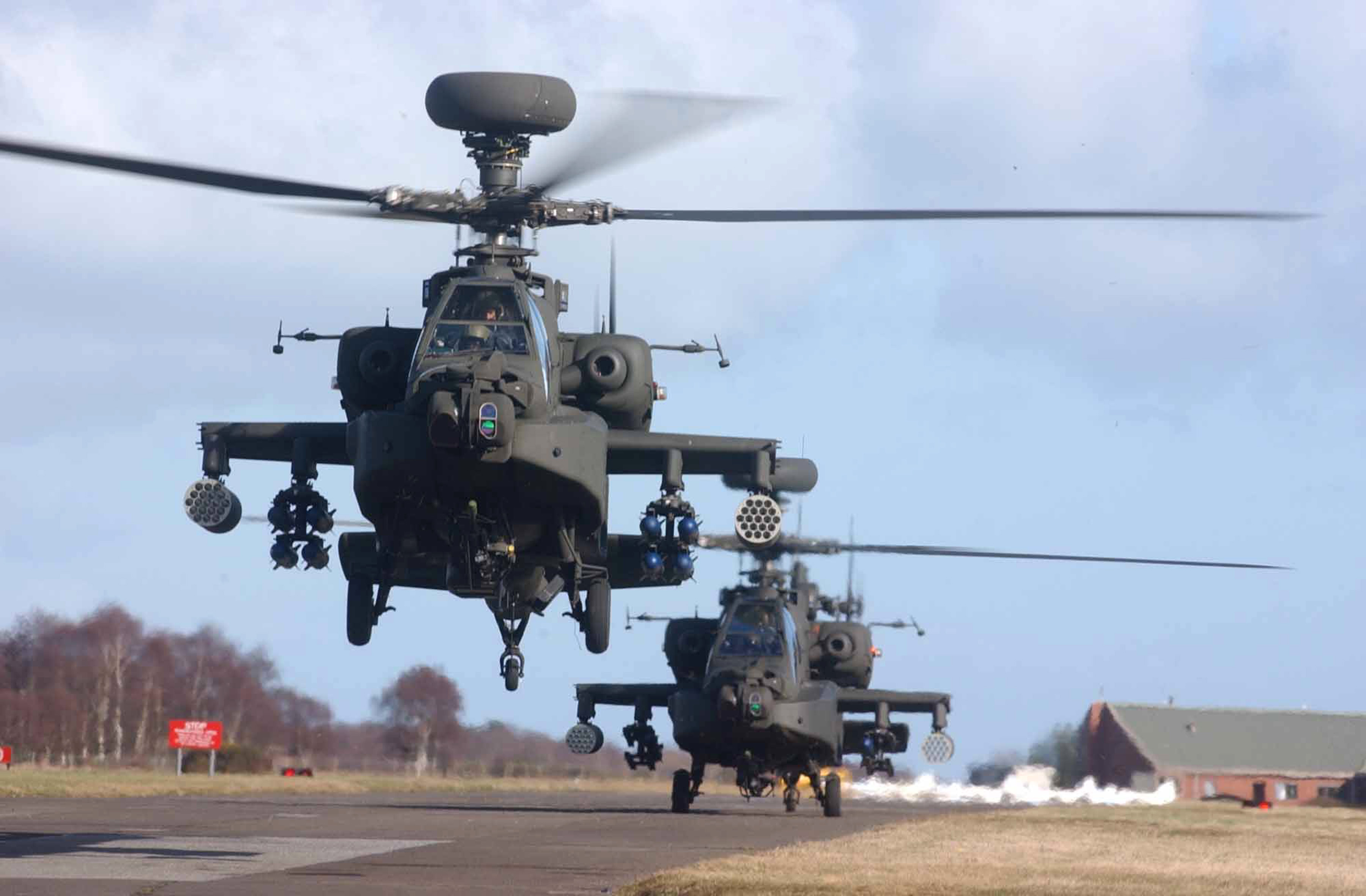 Armys new AH64D Apache Longbow helicopters depart from RAF Leuchars. 01 03 2002 MOD 45141491