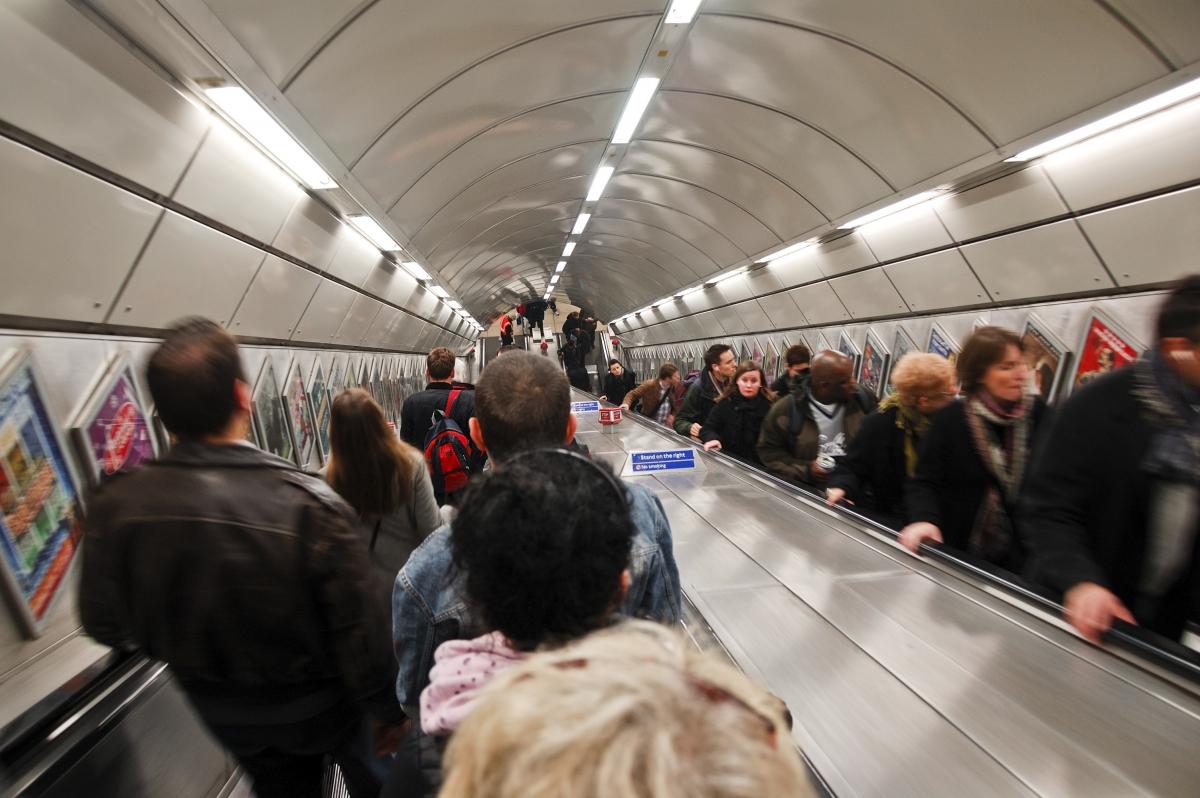 tube london underground escalator commuters