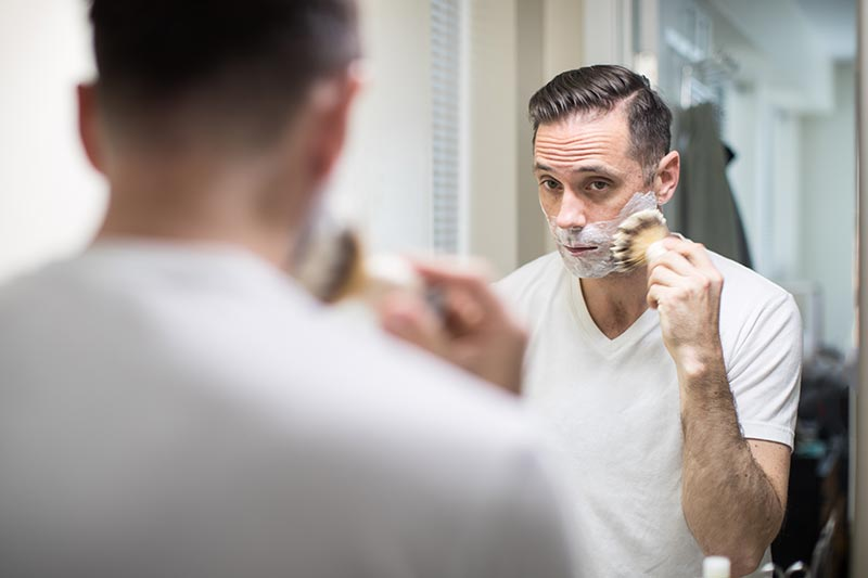 shaving routing using badger hair shave brush in mirror with amazing lather